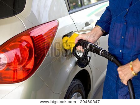 Woman refuelling her car