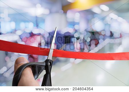 Scissors Are Cutting Red Ribbon. Opening Ceremony Or Event.