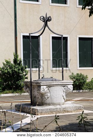 Ancient Stone Well In A Square Of A European City