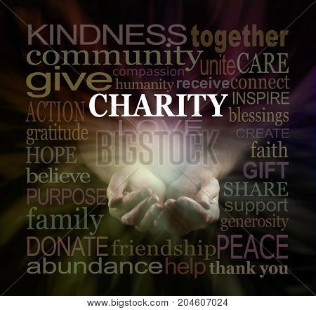 Help our Charity Fundraising campaign - male cupped hands emerging from black background surrounded by a warm colored CHARITY word cloud