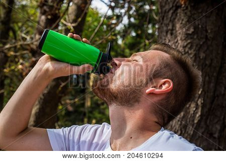 A Fitness Man, After Running In Nature, Drinks His Protein From The Sheik, Acts As A Refreshing, And