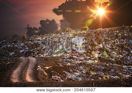 Pollution concept. Garbage pile in trash dump or landfill at twilight.
