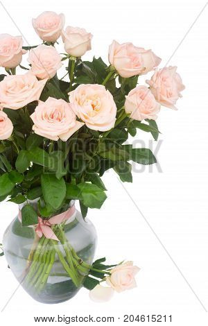 Bunch of pink blooming fresh rose flowers in vase close up isolated on white background