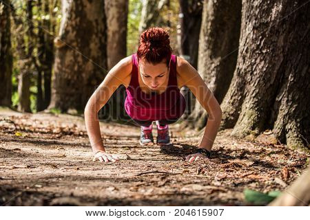 A Girlfriend Of A Good Body, Doing Pushups In The Nature After A Strenuous Running, A Healthy Spirit