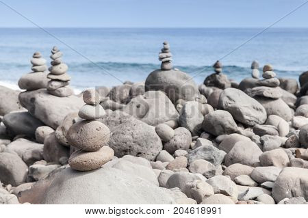 Rock Stacking On The Beach