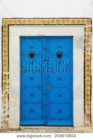 Blue Aged Door With Ornament And Tiles From Sidi Bou Said