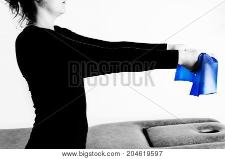 Patient Is Doing Therapy With An Elastic Band For Strengthening  In Her Arms In Silhouette Isolated