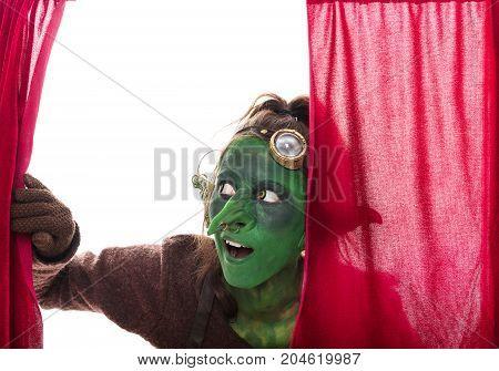 Female Gobling Looking Through A Grand Drape