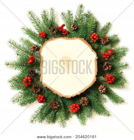 Creative layout made of christmas tree branches with wooden saws as blank on white background. Top view. Christmas concept.