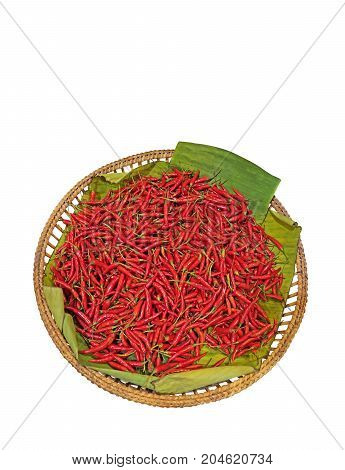 Red Cayenne Pepper with Banana Leaf in The Wicker Basket Isolated on White Background Clipping Path