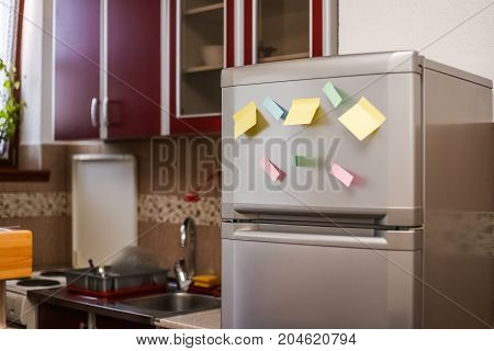 Empty Paper Sheet On Refrigerator Door With Magnetic Clip Paper Note For Add Text Message.