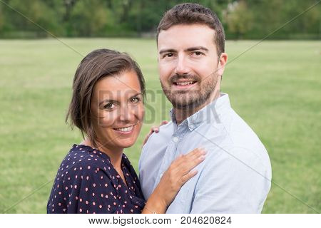 Woman Hugging Her Man Outdoor In A Park