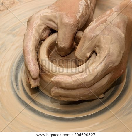 Hands In Clay At Process Of Making Ceramic On Pottery Wheel