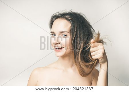 Woman demonstrate healthy hairs,no hair problems,healt care