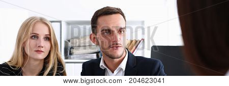 Group of people sit in office deliberate on problem portrait. White collar talk and listen idea discuss profit review sale market debate train lawyer document study finance adviser job concept