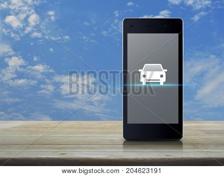 Car flat icon on modern smart phone screen on wooden table over blue sky with white clouds Internet business service transportation concept