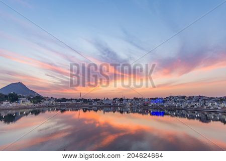 Colorful Sky And Clouds Over Pushkar, Rajasthan, India. Temples, Buildings And Colors Reflecting On