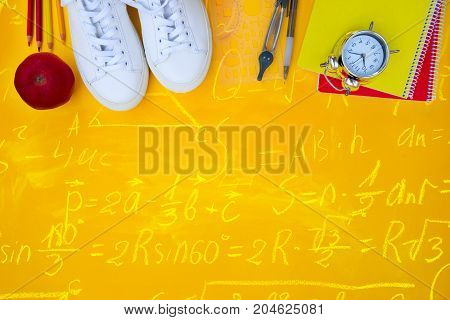 back to school border - white shoes with school supplies with math formulas
