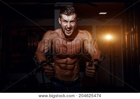 Muscular Bodybuilder Handsome Men Doing Exercises In Gym With Naked Torso. Strong Athletic Guy With