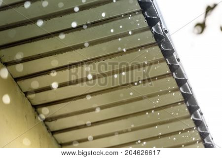 rain flows down from the roof. Close-up. The rainy season