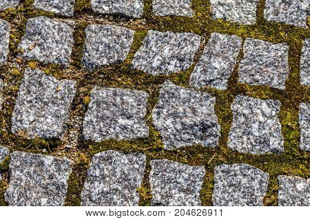 Abstract Background Of Old Cobblestone Pavement Texture With Natural Patterns View From Above