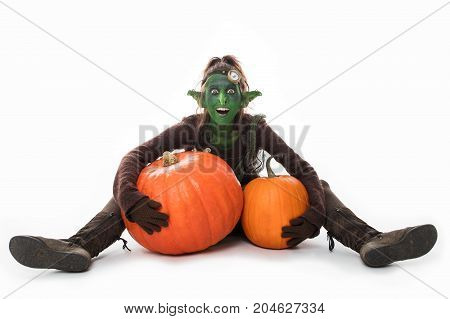 Female Green Goblin With Pumpkins, Halloween