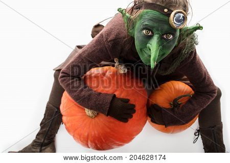 female Goblin with pumpkins freaky halloween costume