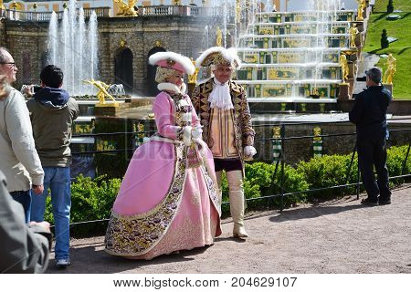 Peterhof, Russia - June 03. 2017. A costumed actors under the old royal personages
