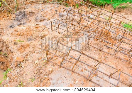 steel post on ground in construction work industry at building site