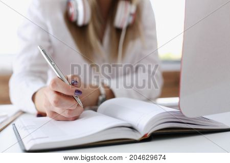 Female Hands Making Notes With Silver Pen
