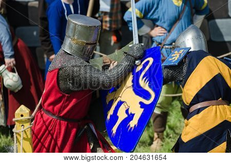 Moscow,russia-june 06,2016: Medieval Warriors Fight On Duel. Knights Struggle In Armour With Swords