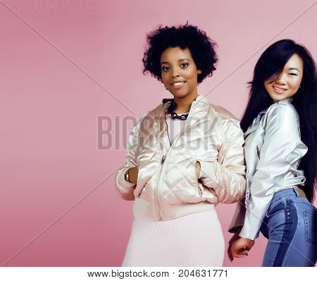 different nation girls with diversuty in skin, hair. scandinavian, african american cheerful emotional posing on pink background, woman day celebration, lifestyle people concept close up
