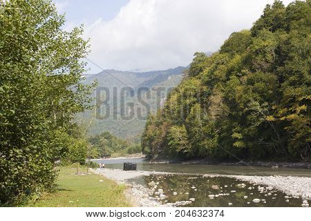 Beautiful landscape with river and mountains. The White river is in the North Caucasus