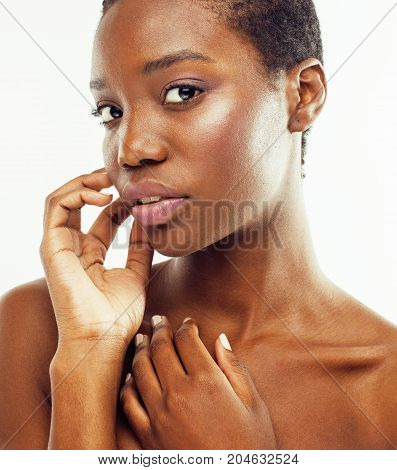 young pretty african american woman naked taking care of her skin isolated on white background, healthcare people concept close up