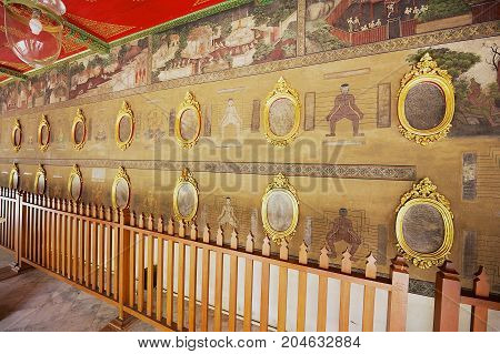BANGKOK, THAILAND - MAY 20, 2009: Exterior of the mural art wall demonstrating important massage point at Wat Pho monastery in Bangkok, Thailand.