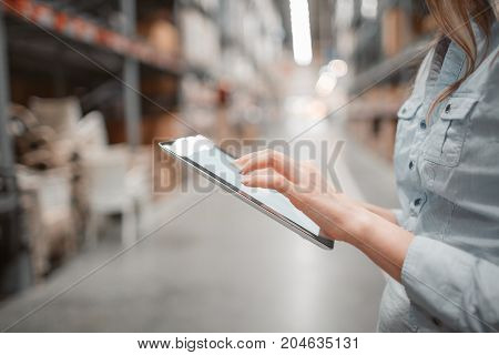 stock taking. beautiful young woman worker of furniture store. light stock