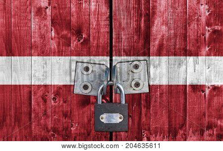 Latvia flag on door with padlock close