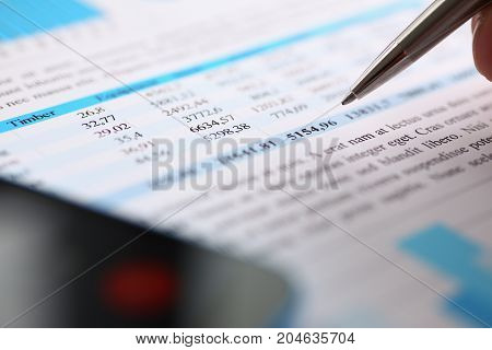 Financial Statistics Documents On Clipboard Pad At Office Table Closeup