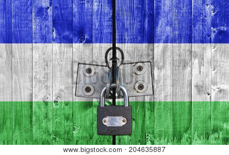 Lesotho flag on door with padlock close