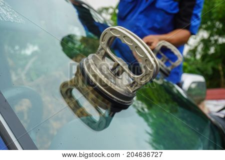 Glazier Using Tools Repairing To Fix Crack Broken Windshield On The Front Window Glass Of The Machin