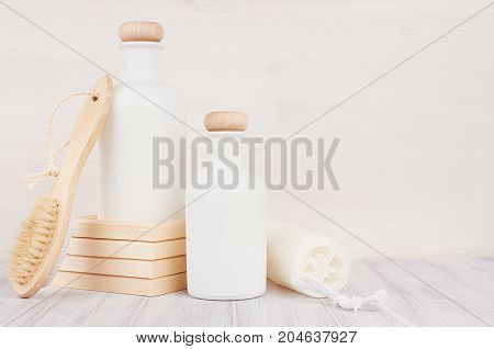 Bathroom interior. Blank white cosmetics bottles with shower puff comb on white wood board mock up. Soft elegant home decor for advertising designers branding identity cover.
