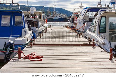 wooden pier for motor boats and sailing yachts
