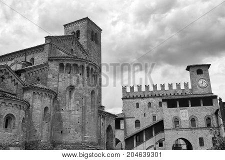 Castell'Arquato (Piacenza Emilia Romagna Italy) Palazzo del Podestà and Santa Maria church medieval buildings in the main square. Black and white