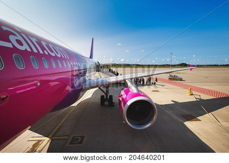 Gdansk Poland August 24 2017: People are boarding to the aircraft of Wizz Air at the airport of Lech Walesa