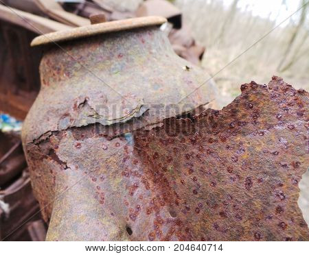 a close up of an Extremely rusted car engine