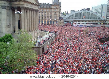 Crowds of fans await the arrival of Liverpool FC after the won the European Cup. 2005