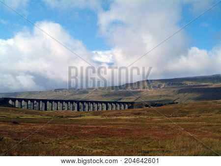 The Ribblehead Viaduct crossing wild countryside in Yorkshire