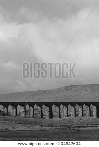 A black and White photo of Ribblehead Viaduct in Yorkshire