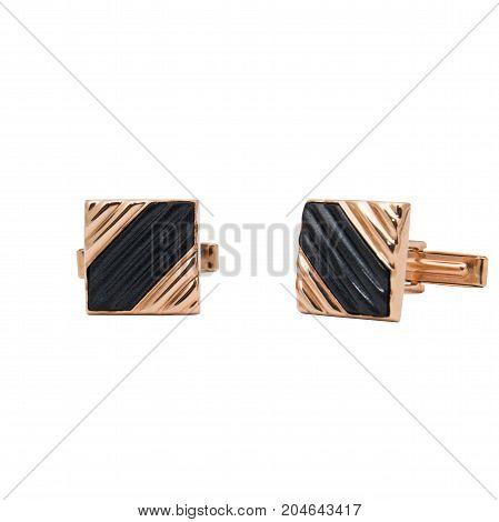 Masculine accessorie - golden cufflinks isolated on white background