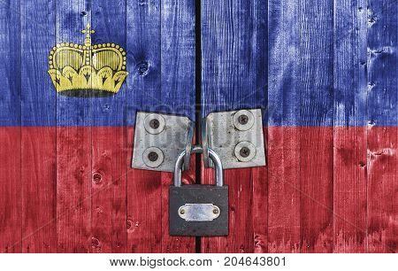 Liechtenstein flag on door with padlock close